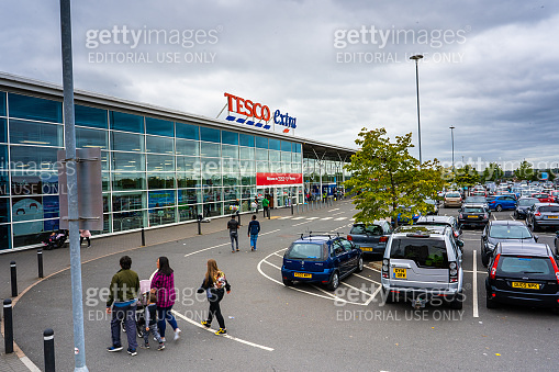 Shoppers head to the large Tesco Express store, shop in Hanley, Stoke on Trent