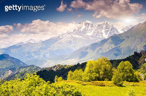 Beautiful view of alpine meadows at the foot of  Mt. Ushba. Upper Svaneti, Georgia, Europe. Caucasus mountains.