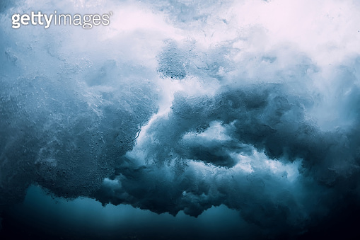 Wave underwater. Blue ocean in underwater