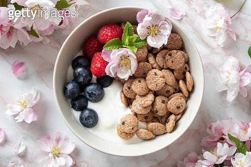 Breakfast cereals with yogurt, blueberries, raspberries