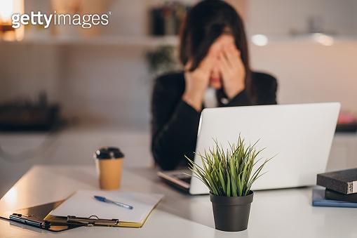 Businesswoman working in her office