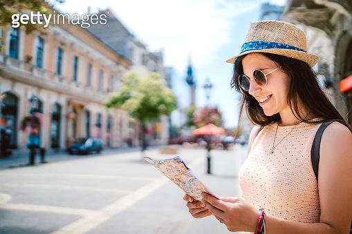 Female tourist exploring city
