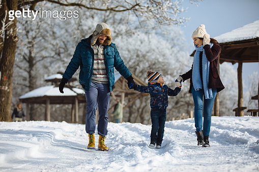 Family enjoying winter walk in the forest