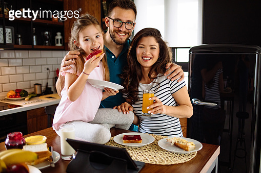 Family at home starting their day in the kitchen