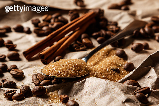 Spoon with brown sugar and coffee beans