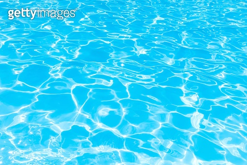 Blue water transparent and ripple wave in swimming pool, Beautiful water surface in pool with bright sunny reflection for background