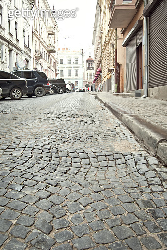 Paving the street in the city. Replacement of old paving tiles. Repairs. Chernivtsi, Ukraine, Europe, March 2019.