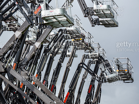 Group of aerial work platforms for construction and material handling. Close-up on the metal lift