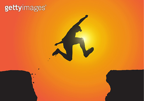 Silhouette of man jumping over the cliffs on golden sunrise background, achievement, success and winning concept vector illustration