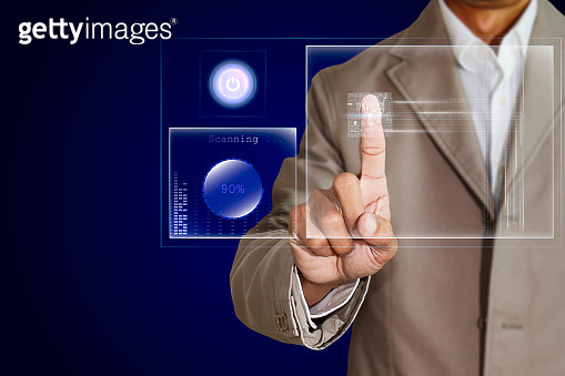 Businessman scanning fingerprint on transparent screen, futuristic biometric security system concept