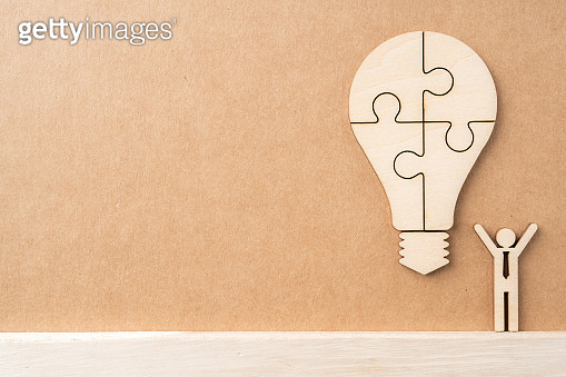 wooden businessman and light bulb, idea concept