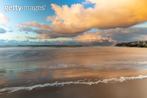 Autumn clouds over the rough sea. Sea beach in Central Europe. Autumn season.