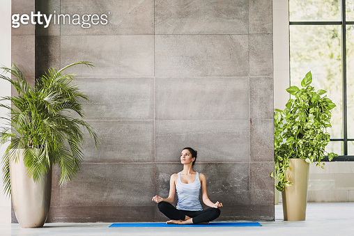 Girl practicing yoga in yoga class. Meditation, relaxation concept