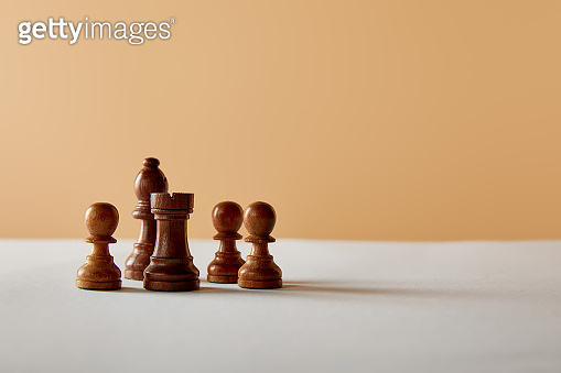 wooden chess on white table and beige background