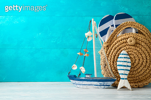 Summer vacation background with nautical decorations and  fashion bag on wooden table