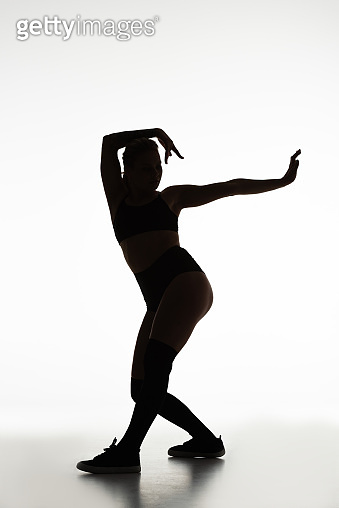 silhouette of girl twerking isolated on white