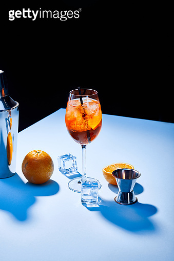 cocktail Aperol Spritz, oranges, shaker, ice cubes and measuring cup