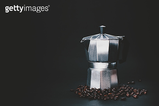 Dark and moody shot of a coffee maker.