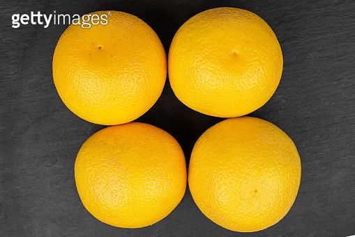 Fresh bright orange on grey stone
