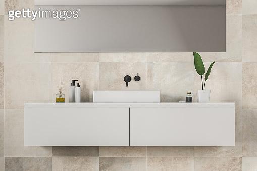 Sink in beige tile bathroom