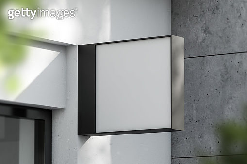 Square mock up sign on concrete building facade