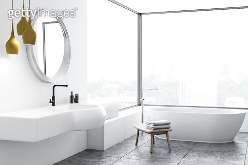 Panoramic bathroom corner, white tub and sink