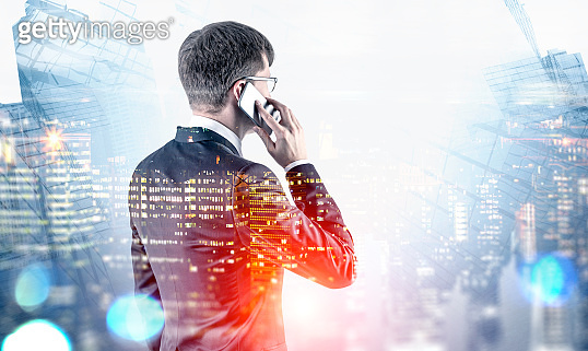 Businessman on phone in city