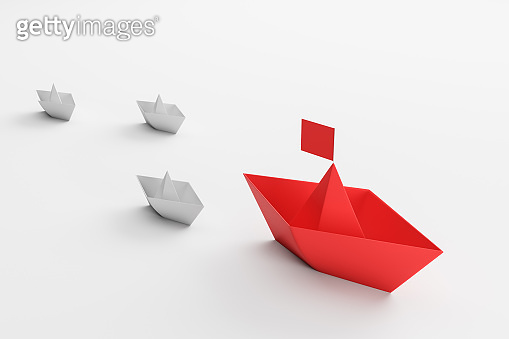 Leadership concept, red and white paper ships