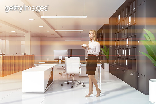 Woman in office with bookcases