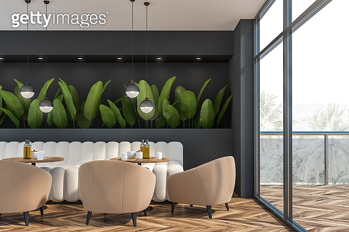 Gray restaurant interior with plants