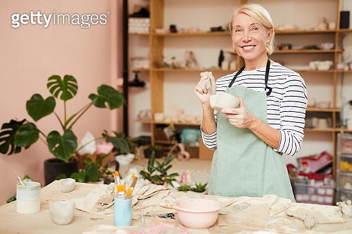 Female Potter in Workshop
