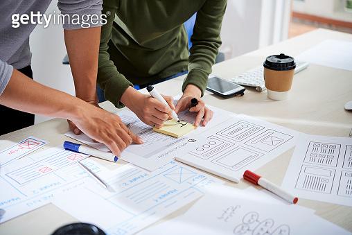 UX designers working on website wireframe design