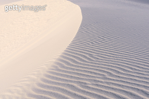 Desert sand waves background during sunset