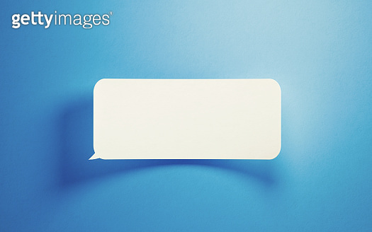 White Chat Bubble On Blue Background