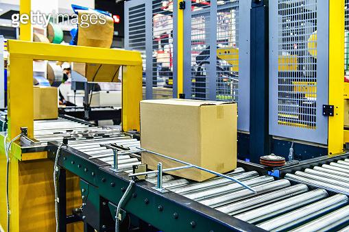 Cardboard boxes on conveyor belt.industry concept
