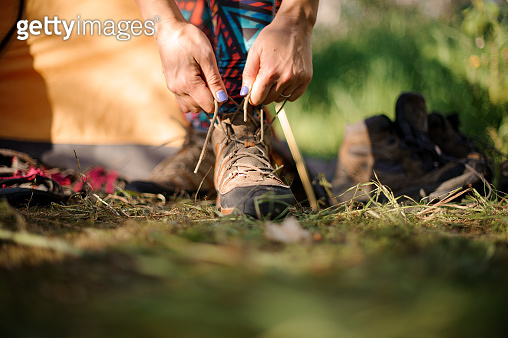 Close-up of a woman tying hiking shoes
