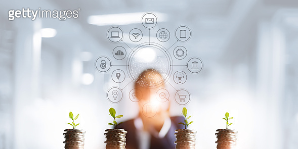 Businessman holding a tree sprout growing on coins, abstract growth investing. Finance and icon customer, banking network connection, digital marketing, investment growth and business technology.