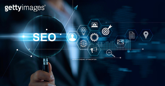 SEO Search Engine Optimization Marketing concept. Businessman with magnifying glass in hand searching on website and network. Digital online marketing. Business Technology.