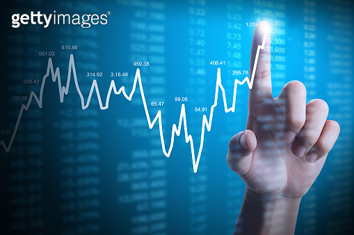 businessman with financial chart symbols coming from hand