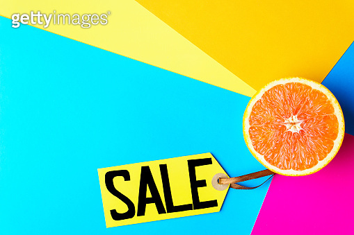 summer vacation sale, price tag and half of orange