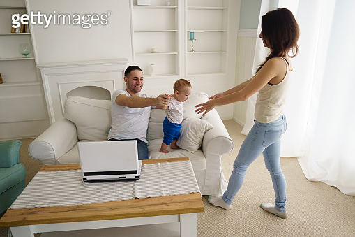 happy family and baby boy playing at home