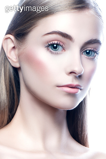 Close-up beauty face of young pretty model woman with makeup, blue eyes, healthy skin
