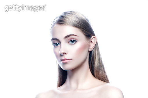 Beauty young woman studio portrait. Blonde hair, perfect skin, blue eyes