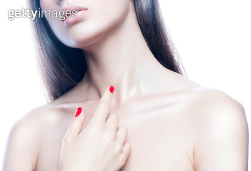 Lips, hand, shoulder, part of beauty young model woman face, perfect skin