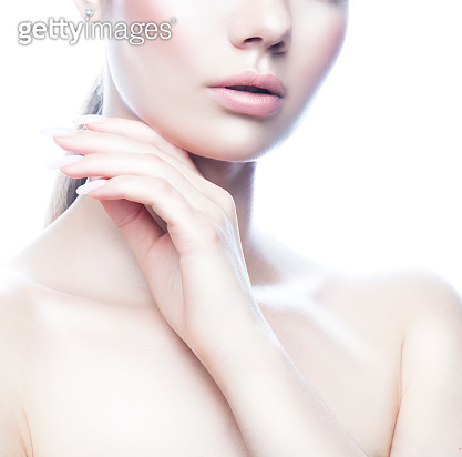 Part of beauty woman face with lips, shoulder and hand with clean skin and natural make-up.