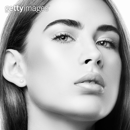 Close-up beauty face of young woman, healthy perfect skin. Black and white
