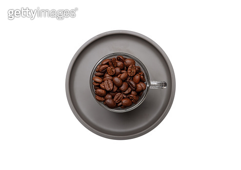 Coffee cup and beans isolated cutout on white color background, top view