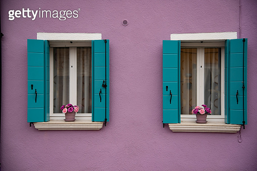 Detail of windows and colorful painted door, Burano island, Venice, Veneto, Italy, Europe.