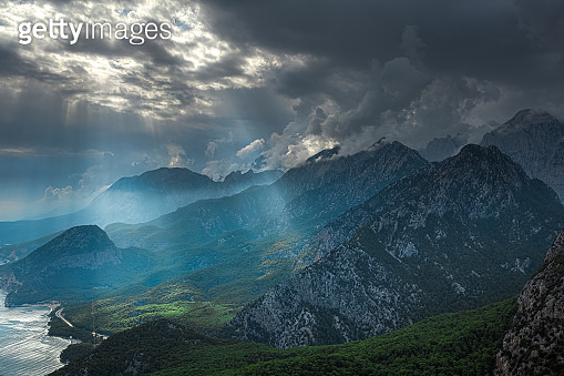 mountain landscape with charming clouds and soft sun rays