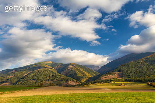 Piedmont landscape with meadows in the morning light at autumn.